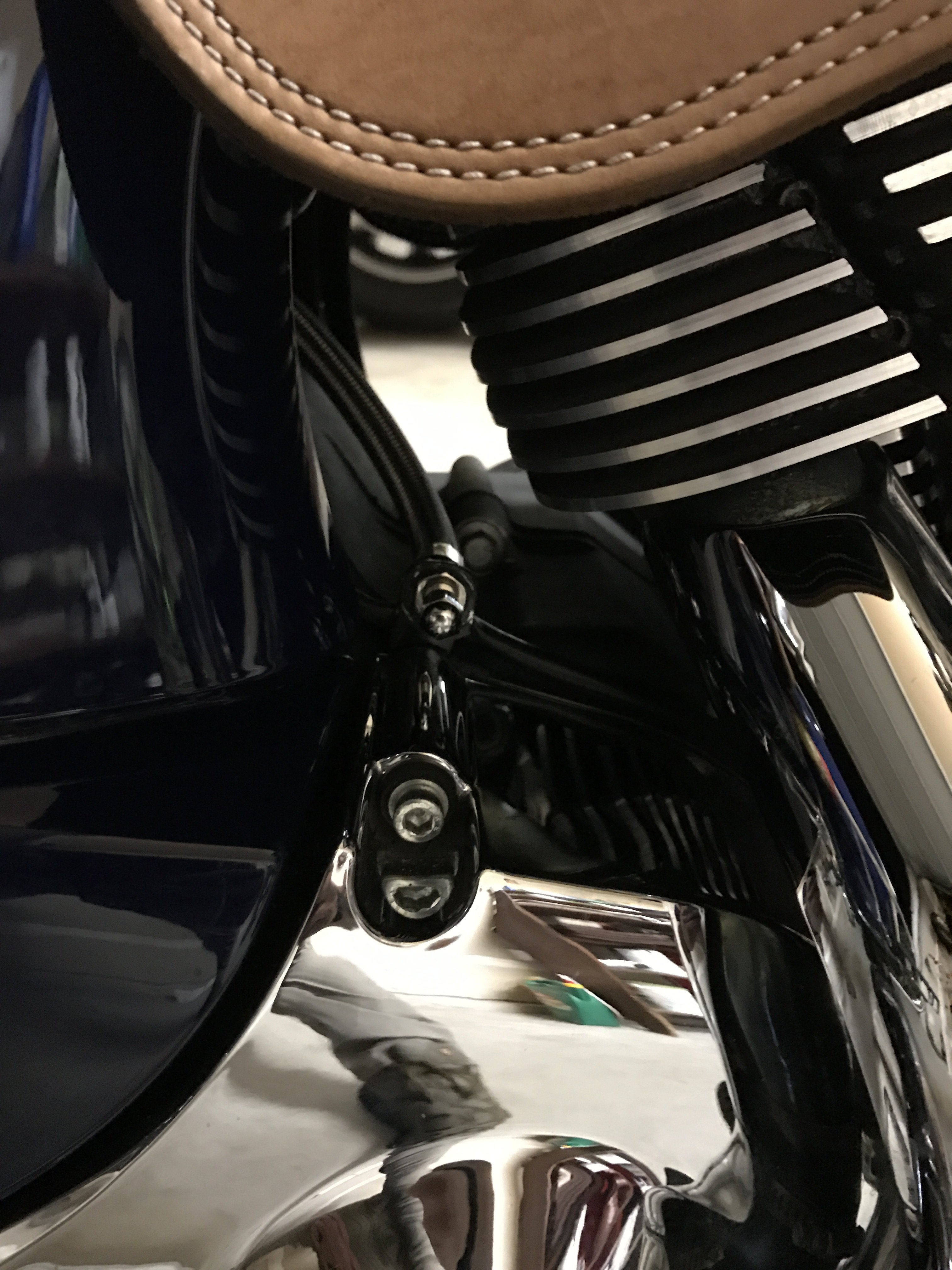 Relocation of the air shock fill valve | Indian Motorcycle Forum